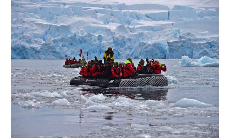 Tourists travelling on the Hurtigruten hybrid expedition cruise ship, MS Roald Amundsen, visit the Chiriguano Bay onboard boats,