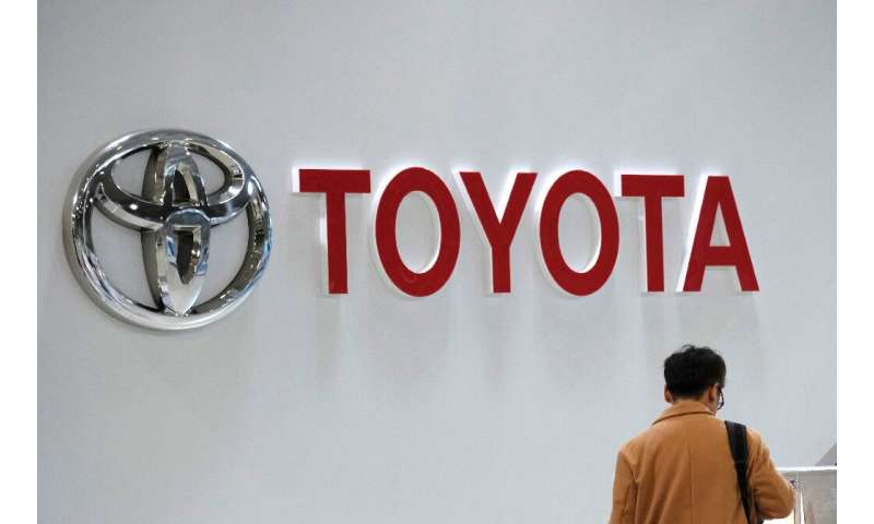 Toyota booked record sales but its profits were stlil down by a quarter