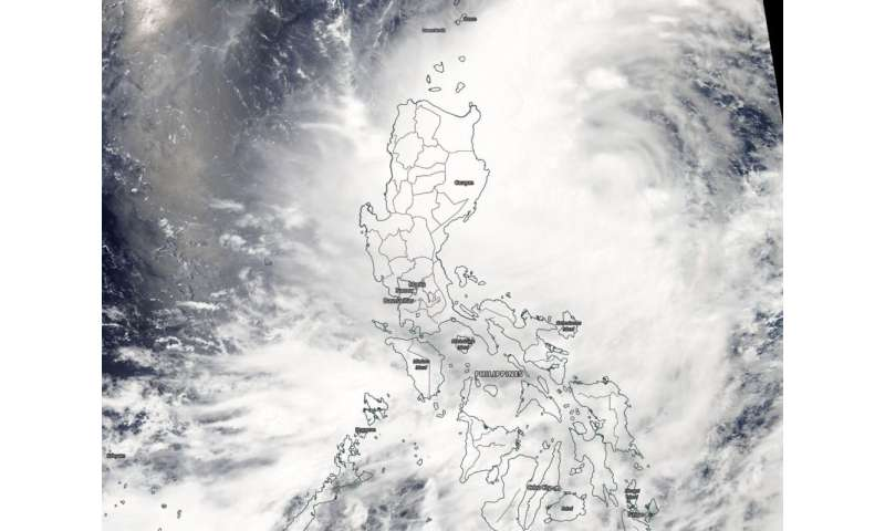 Tropical Depression Danas affecting Philippines in NASA satellite imagery