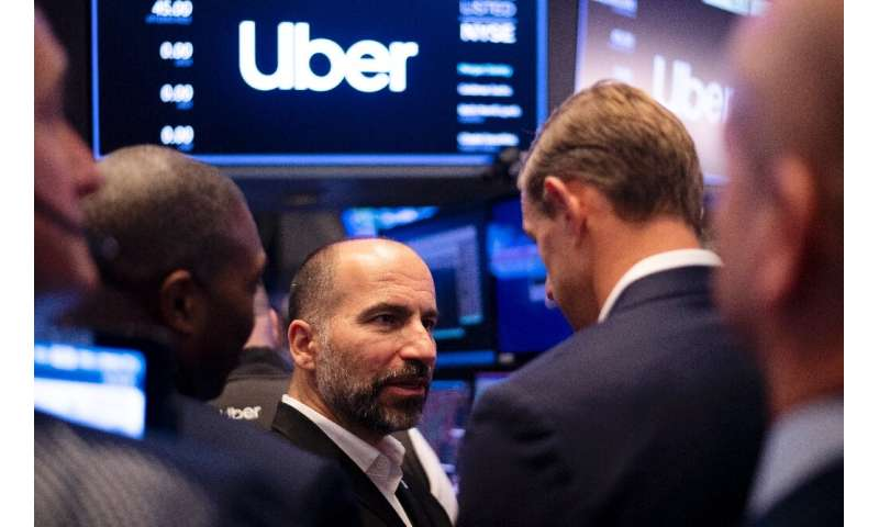 Uber CEO Dara Khosrowshahi talks to traders after the opening bell at the New York Stock Exchange where the ride-hailing giant's