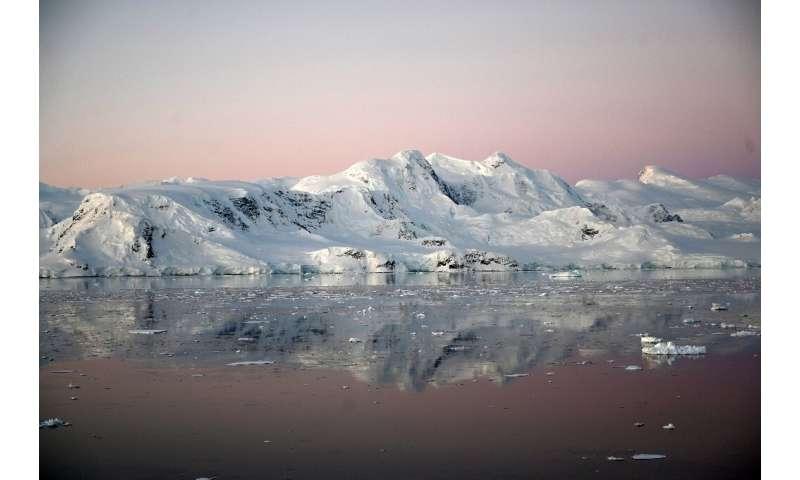 View of a glacier at sunset at Chiriguano Bay in South Shetland Islands, Antarctica