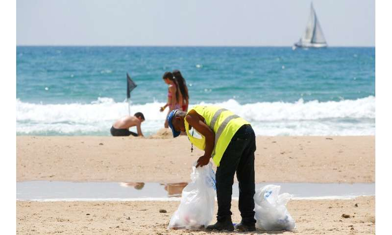 Volunteers join beach cleanups in Israel, whose Tel Aviv coastline was found to be the third most polluted by plastic waste in t