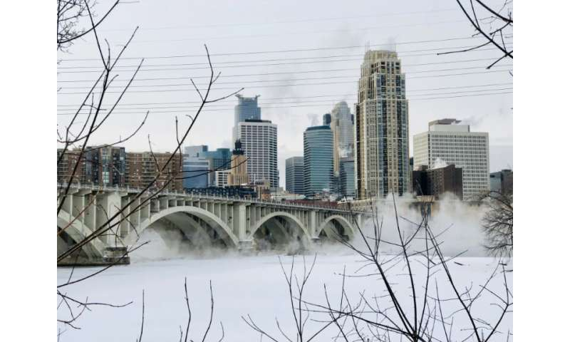 Water vapor rises above St. Anthony Falls on the Mississippi River beneath the Stone Arch Bridge during frigid temperatures on J