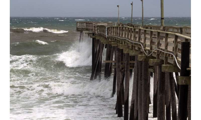 Waves crash as Hurricane Dorian make its way to Cape Hatteras in North Carolina, which the state's governor warned is facing a &