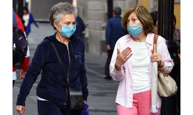 Women wear face masks in Mexico City on May 17, 2019. A thick layer of smog enveloping Mexico City, resulted in an air pollution