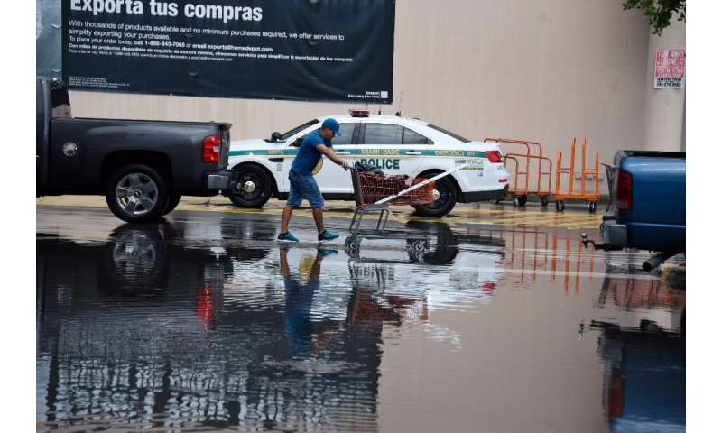Workers help residents at Home Depot where they are buying supplies on August 29, 2019, as they prepare for Hurricane Dorian