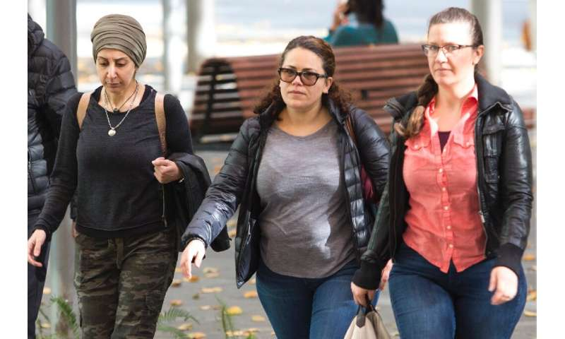 Zeina Abouammo, second left, whose husband, US citizen Ahmad Abouammo, is accused of using his position at Twitter to spy on acc