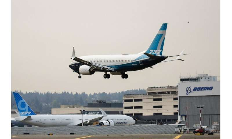 A Boeing 737 MAX airliner piloted by Federal Aviation Administration (FAA) Administrator Steve Dickson lands following an evalua