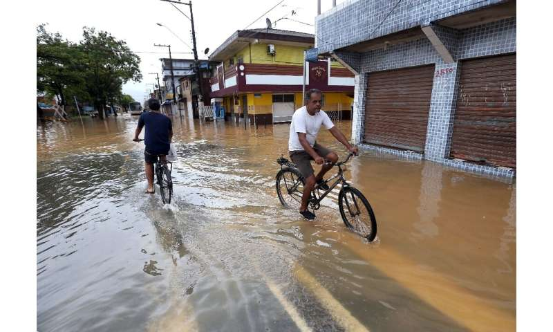 A flooded street in the Morro do Macaco Molhado favela in Guaruja, in Brazil's Sao Paulo state