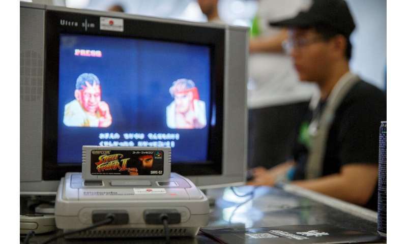 A group of Japanese retro gaming fans is offering 100 Super Nintendo consoles, similar to the one pictured here, to cooped-up ki