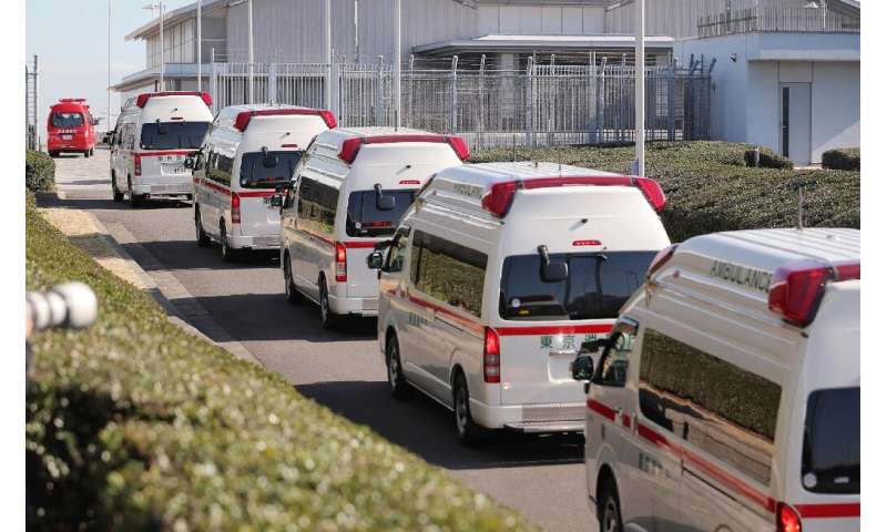 Ambulances arrive at Haneda airport in Tokyo to meet a second charter flight carrying Japanese citizens from the Chinese city of
