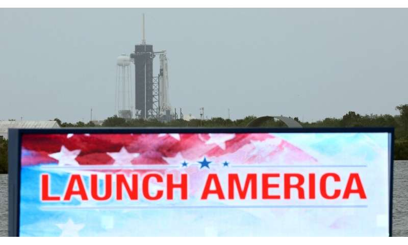 A SpaceX Falcon 9 rocket with the Crew Dragon spacecraft sits atop launch complex 39A at the Kennedy Space Center in Florida on