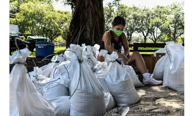 A woman prepares sand bags for the residents of Palmetto Bay near Miami as Florida prepares for the impact of Isaias