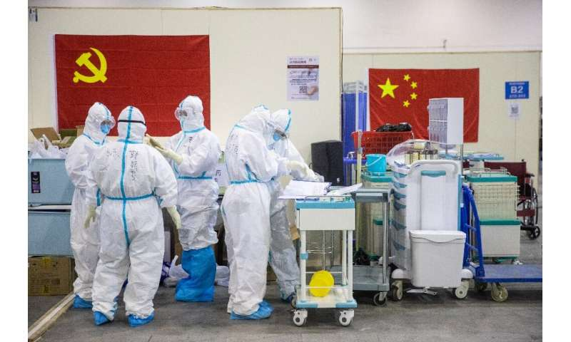 China has placed about 56 million people in hard-hit central Hubei under quarantine, virtually sealing off the province from the