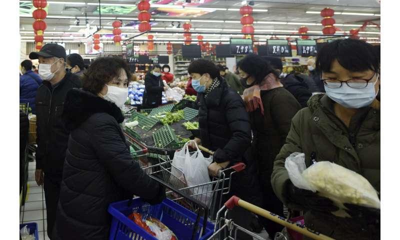 China scrambles to keep cities in virus lockdown fed