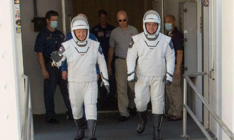 Douglas Hurley an Robert Behnken are seen in their spacesuits on May 23, 2020