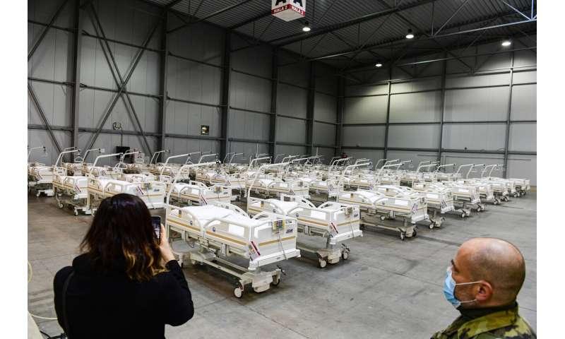 Europeans face more curfews, restrictions, as virus surges