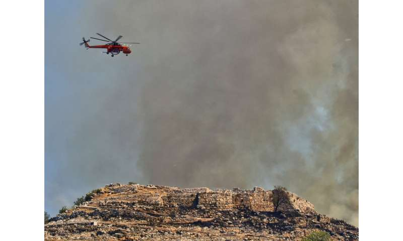 Greece: Wildfire blackens gate of ancient fortress city