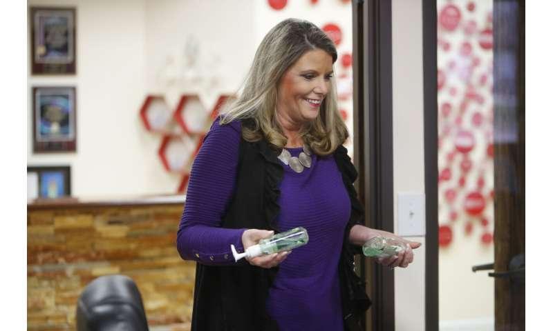 Hand sanitizers, flu shots -- businesses' defense against flu