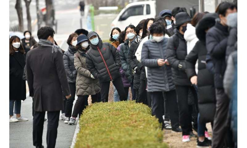 Huge lines formed at a Seoul supermarket as people arrived to buy face masks
