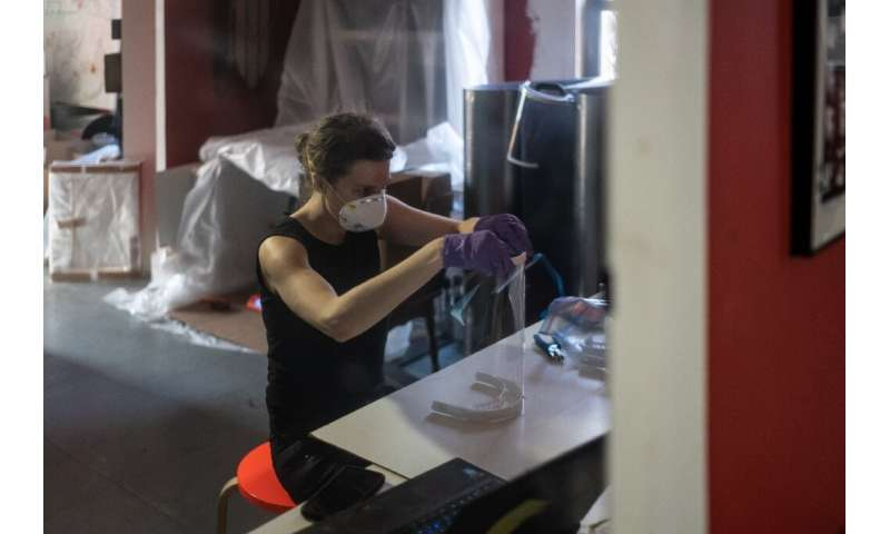 Luba Drozd makes protective shields for health workers in her apartment on her 3D printers, having raised money for supplies in