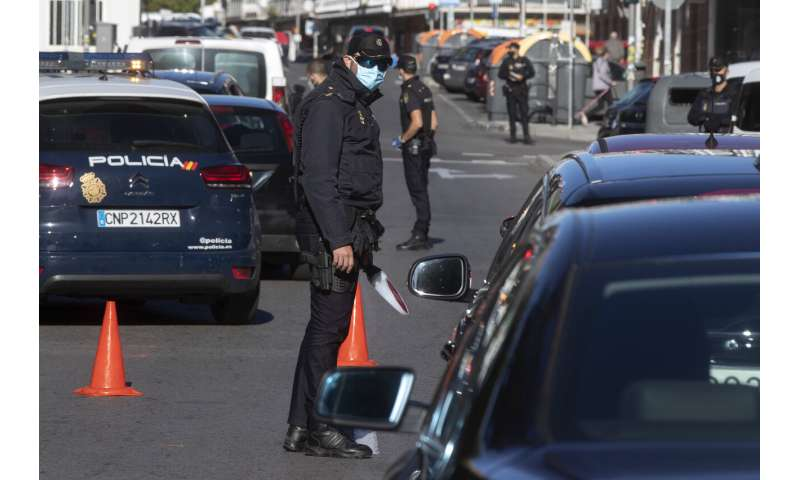 Madrid begins with a partial virus lockdown amid political turmoil