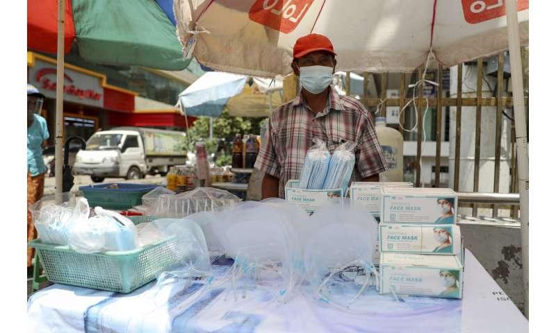 Myanmar bans flights, travel from Yangon as virus spreads