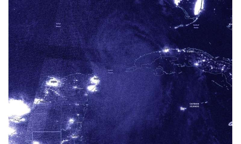 NASA gathers nighttime images of Laura becoming a Hurricane