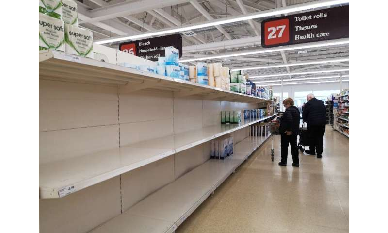 Near empty shelves on the toilet paper aisle in a supermarket in London after stockpiling by consumers