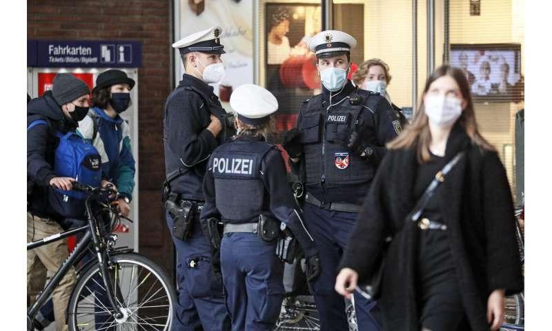 New virus restrictions in Europe; Merkel warns of hard days