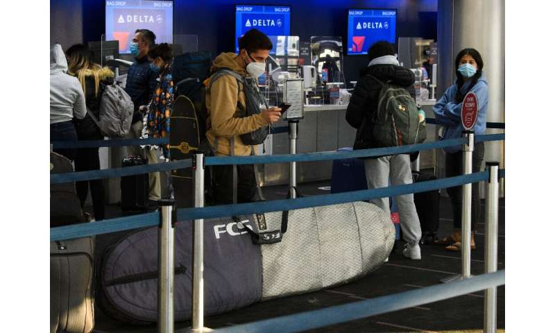 Passengers wait in line to check-in for Delta Air Lines flights at Los Angeles International Airport ahead of the Thanksgiving h