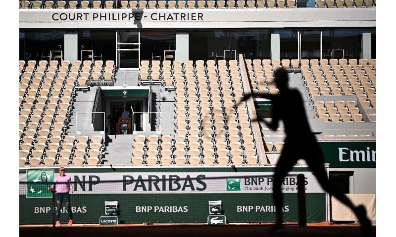 The players take part in a French Open warm-up with no spectators at Roland Garros