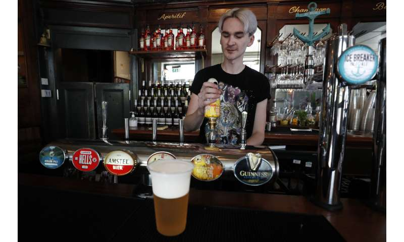 Pubs, restaurants in England to reopen as virus toll eases