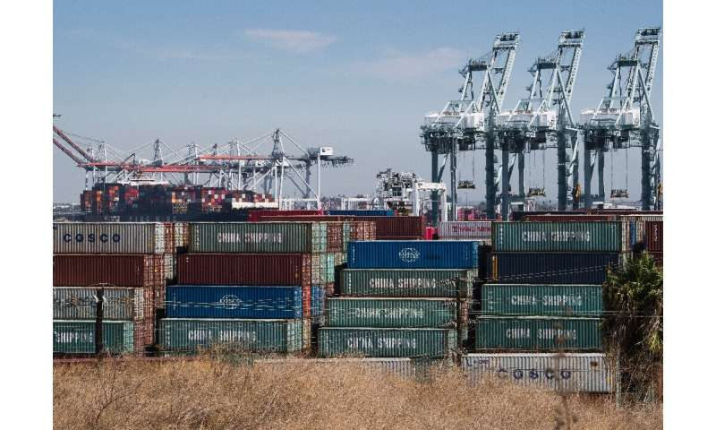 Shipping containers from China and other Asian countries are unloaded at the Port of Los Angeles in Long Beach, California on Se