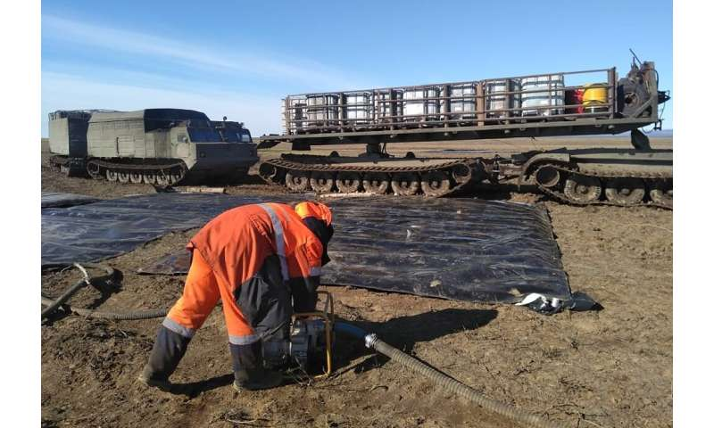 Specialists called in from across Russia managed to stop the spill from spreading further