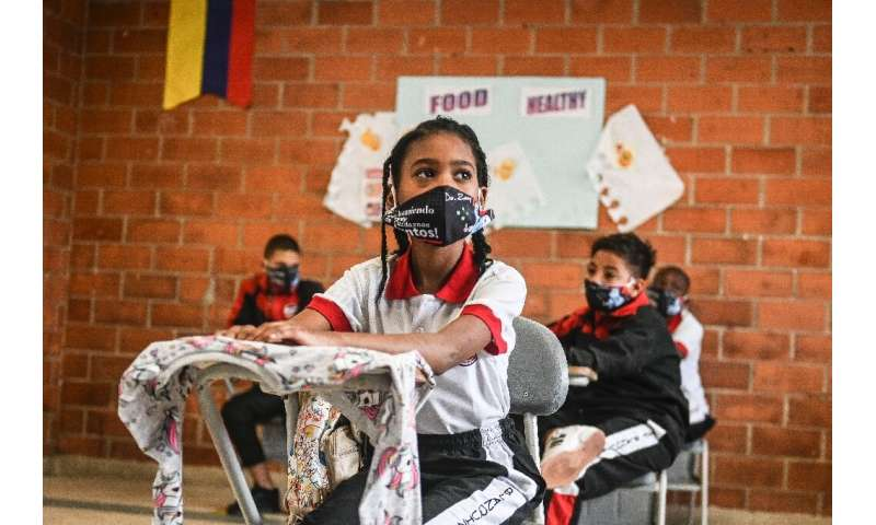 Students attend a class at the Blanquizal Public school during its reopening in Medellin, Colombia