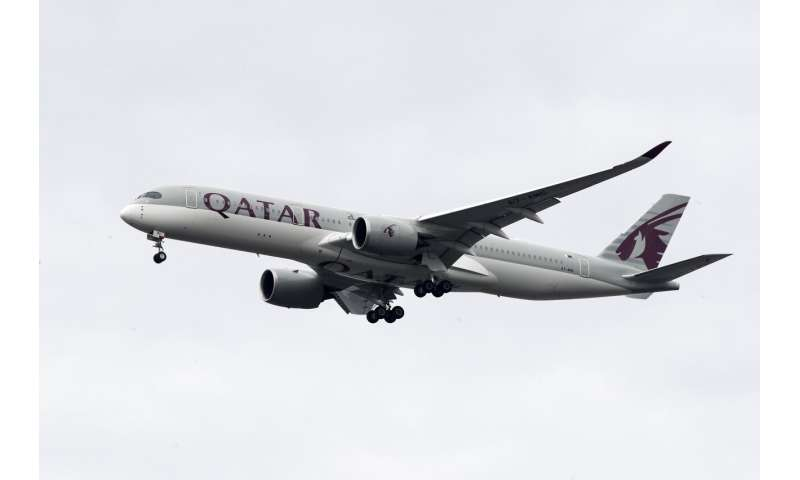 Stung by virus, long-haul carrier Qatar Airways cuts jobs