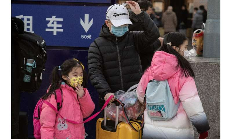 The discovery of human-to-human transmission comes as hundreds of millions of people are criss-crossing China in packed trains,