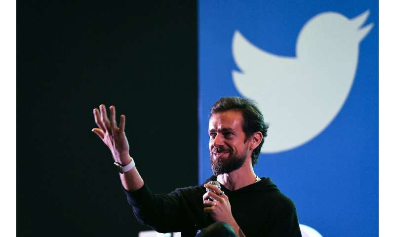 Twitter CEO and co-founder Jack Dorsey, seen during a 2018 visit to India, said he is rethinking his plan to spend as much as si