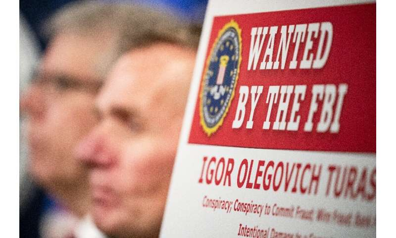 Two Russian nationals indicted on charges of hacking in December are believed to be behind a new ransomware scheme targeting US