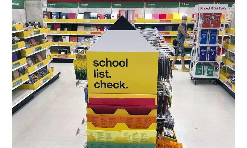 US debates school reopening, WHO warns 'no return to normal'