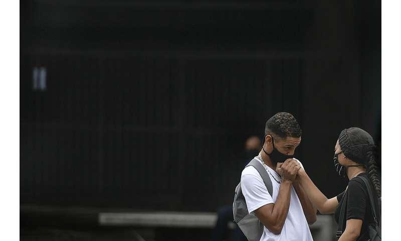 Virus surges in India, Philippines; Australia imposes curfew