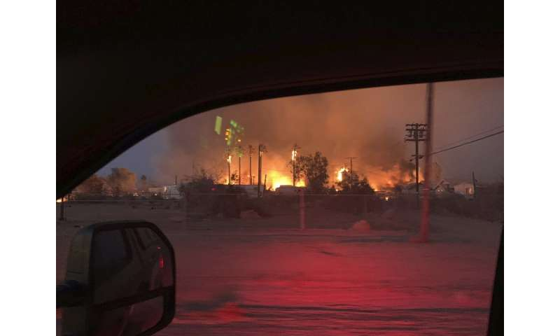 Wildfire burns homes in Southern California desert town