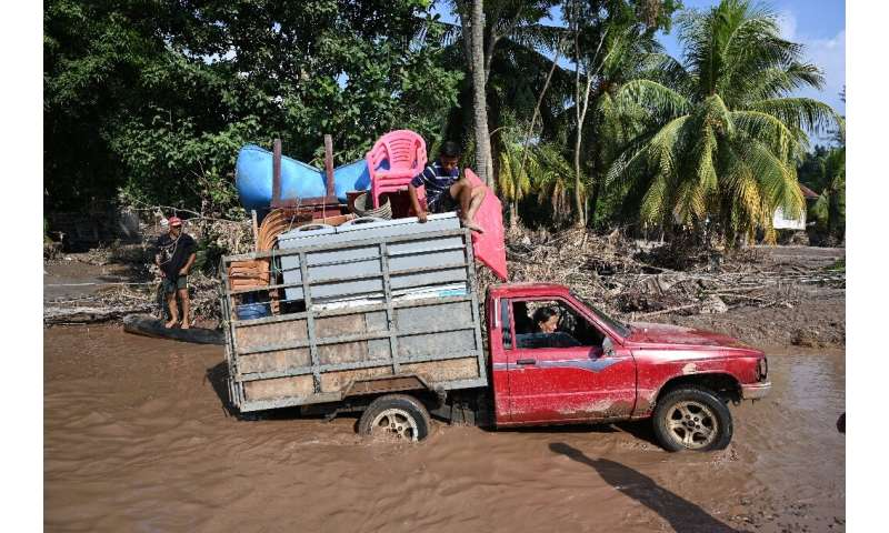Workers evacuate from a banana plantation near El Progreso, Honduras, ahead of Hurricane Iota, in November 2020