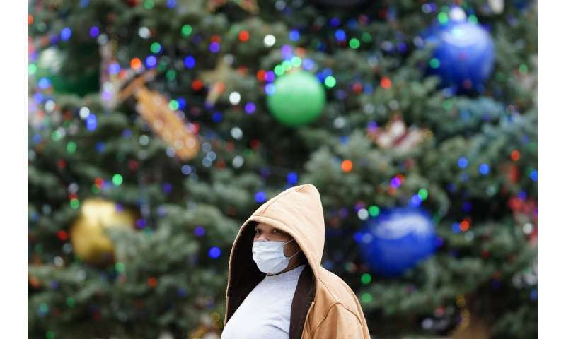 US virus deaths hit record levels with the holidays ahead