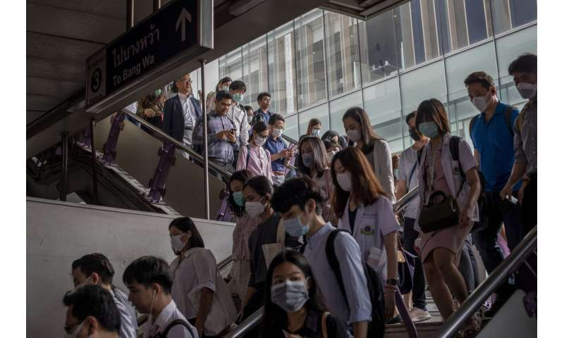 Hong Kong reports virus death as workers strike at hospitals
