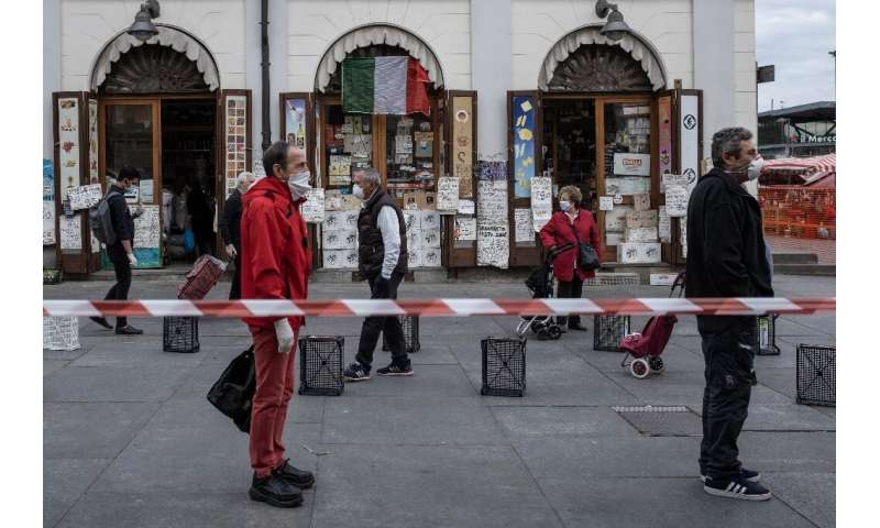 Social distancing measures are being encouraged across Italy as it emerges from lockdown