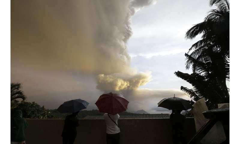 Volcano erupts near Manila; villagers flee, airports shut