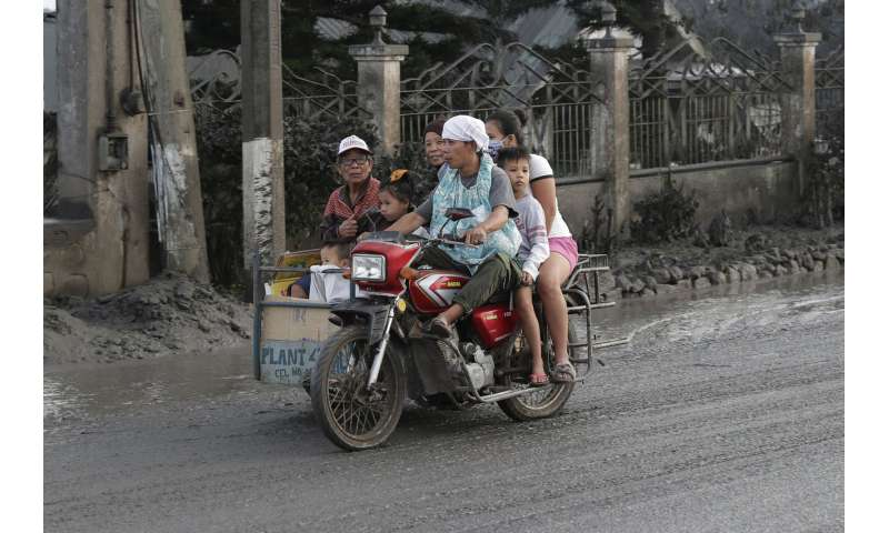 Lava gushes from volcano near Manila; tens of thousands flee