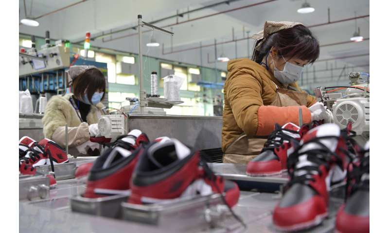 China's factories try to shield workers as output revives